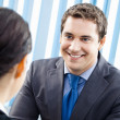 Happy businesspeople, or business man and client — Stock Photo