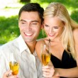 Young happy couple with champagne, outdoor - Stock fotografie