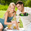 Young happy couple with champagne, outdoor — Stock Photo #12579798