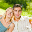 Young happy couple with champagne, outdoor — Stock Photo #12579813