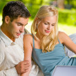 Royalty-Free Stock Photo: Young couple working with laptop, outdoor