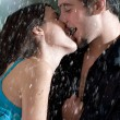 Young couple hugging under a rain - Photo