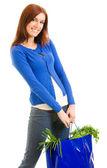 Glada leende kvinna med shopping väska, över vita — Stockfoto