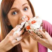 Mujer alegre comiendo pastel, blanco — Foto de Stock