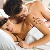 Couple making love in bed — Stock Photo