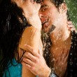 Young couple hugging under a rain — Stock Photo #12580009