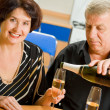 Cheerful senior couple celebrating with champagne — Stock Photo