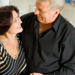 Portrait of senior cheerful couple embracing — Stock Photo