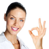 Cheerful businesswoman with okay sign, over white — Stock Photo