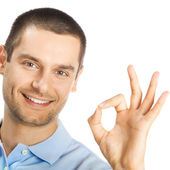 Cheerful man showing okay sign, over white — Stock Photo
