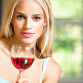 Young woman with glass of red wine — Stock Photo