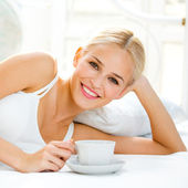 Happy smiling woman at bedroom — Stock Photo