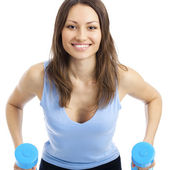 Young woman exercising with dumbbells, isolated — Stock Photo