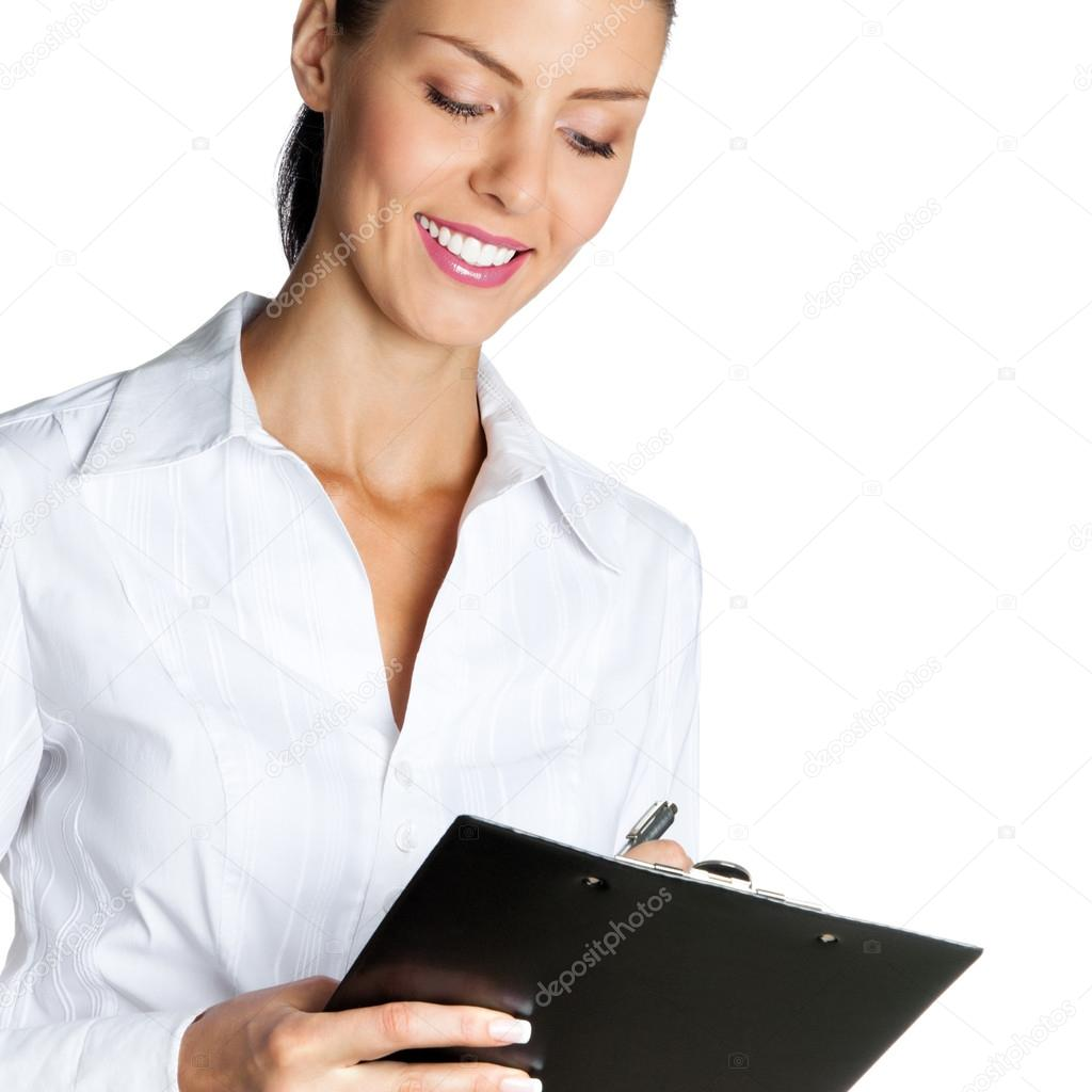 Cheerful beautiful business woman with clipboard writing, isolated over white background — Stock Photo #12724621