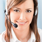 Happy smiling support phone operator at office — Stock Photo
