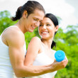 Cheerful couple with dumbbells on workout — Stock Photo #12857051