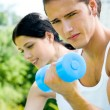 Cheerful couple with dumbbells on workout — Stock Photo #12857147