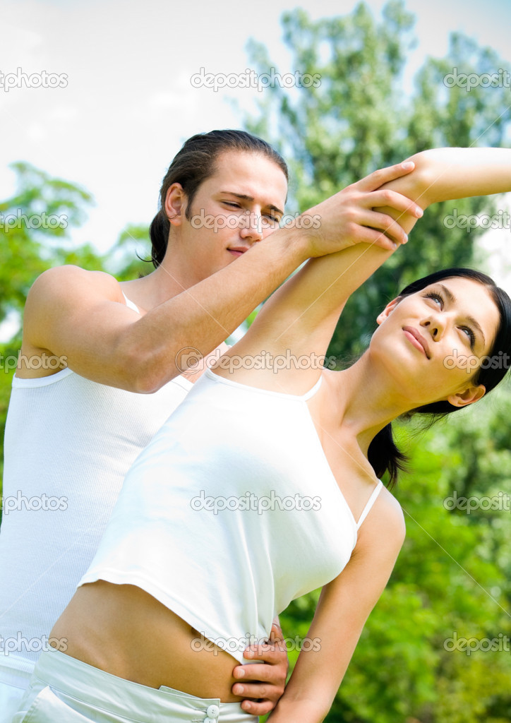 Cheerful young smiling couple on outdoor fitness workout — Stock Photo #12857137