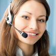 Cheerful smiling support phone operator at office — Stock Photo