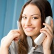 Young business woman with phone at office — Stock Photo