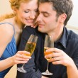 Cheerful couple with champagne — Stock Photo #13189852