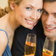 Cheerful couple with champagne — Stock Photo #13189853
