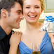 Cheerful amorous couple with gifts, indoors — Stock Photo #13189864