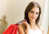 Young happy woman with shopping bags — Stock Photo