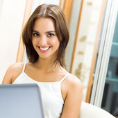 Cheerfull smiling woman working with laptop — Stock Photo