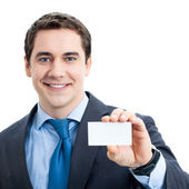 Businessman with businesscard, isolated — Stock Photo