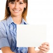 Cheerful business woman showing blank signboard, over white — Stock Photo #13367538