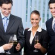 Cheerful business team celebrating with champagne — Stock Photo
