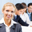 Portrait of happy smiling businesswoman at office — Stock Photo #13546520