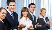 Cheerful business applauding — Stock Photo