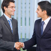 Happy businesspeople handshaking — Stock Photo
