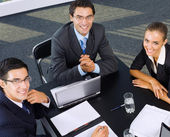 Three businesspeople working with laptop — Stock Photo