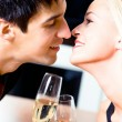 Stock Photo: Couple kissing at restaurant
