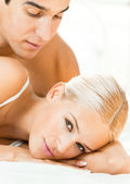 Young attractive couple at bedroom — Stock Photo
