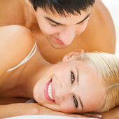 Young embracing cheerful attractive couple — Stock Photo