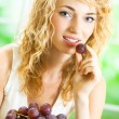 Royalty-Free Stock Photo: Young happy woman with plate of grape