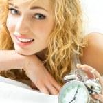 Blond beautiful woman with alarmclock — Stock Photo