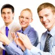 Three happy clapping businesspeople at presentation, meeting, se - Foto Stock