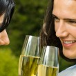 Young happy couple with champagne, outdoor — Stock Photo #13970994