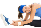 Cheerful smiling woman exercising, over white — Stock Photo