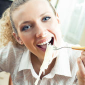 Cheerful woman eating spaghetti — Stock Photo