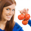 Cheerful woman with tomatoes, over white — Stock Photo #14324977