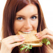 Cheerful woman eating sandwich with cheese — Stock Photo #14325159