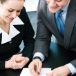 Stock Photo: Businesspeople with documents at office