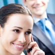 Businesswoman with cellphone at office — Stock Photo