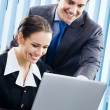 Businesspeople working with laptop at office — Stock Photo #14327015